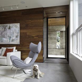 Idee per un soggiorno design con pavimento in cemento e pareti bianche
