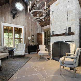 Design ideas for a small country living room in Austin with limestone floors, a standard fireplace and a stone fireplace surround.