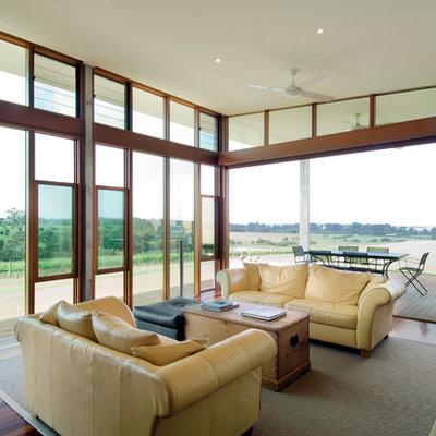 Inspiration for a large modern open concept dark wood floor living room remodel in Melbourne