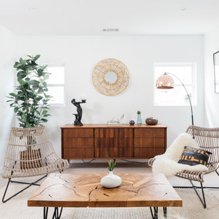 Living room - contemporary light wood floor and beige floor living room idea in Los Angeles with white walls