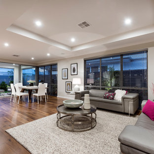 Design ideas for a contemporary open concept living room in Perth with grey walls and medium hardwood floors.