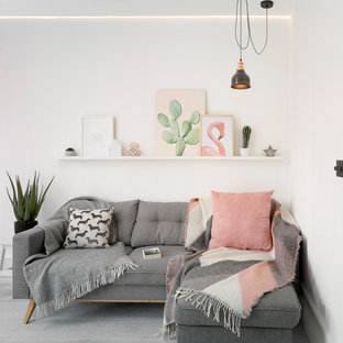Scandi living room in London with white walls and grey floors.