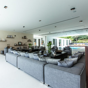 Inspiration for a huge contemporary open concept porcelain floor living room remodel in Los Angeles with white walls