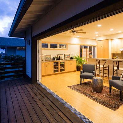 Example of a mid-sized open concept bamboo floor living room design in Hawaii