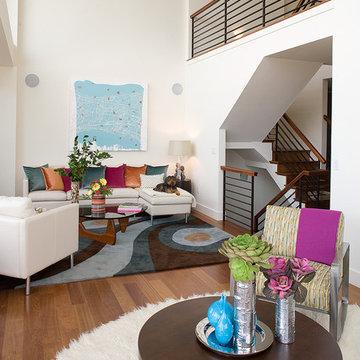 Hillside Sanctuary:  White living room by Kimball Starr Interior Design