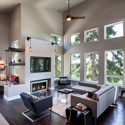 Large trendy open concept dark wood floor living room photo in Portland with gray walls, a wall-mounted tv and a ribbon fireplace