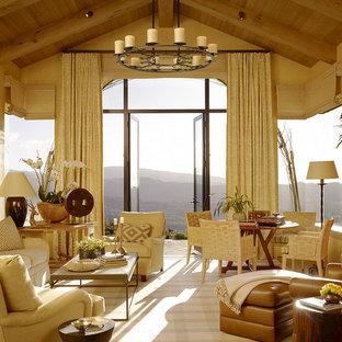 Ejemplo de salón mediterráneo, grande, sin televisor, con chimenea tradicional