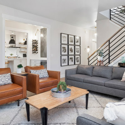 Living room - transitional open concept brown floor living room idea in Other with white walls
