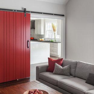 Foto di un soggiorno minimal chiuso con pareti grigie