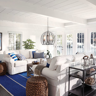 Medium sized coastal formal open plan living room in Chicago with white walls, vinyl flooring, no fireplace, no tv and brown floors.