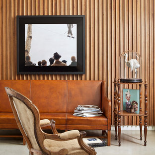 Inspiration for an eclectic concrete floor living room remodel in Los Angeles with brown walls