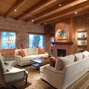 Inspiration for a mid-sized southwestern open concept dark wood floor living room remodel in Phoenix with a music area, a standard fireplace and red walls