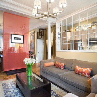 Inspiration for a timeless living room remodel in New York with beige walls