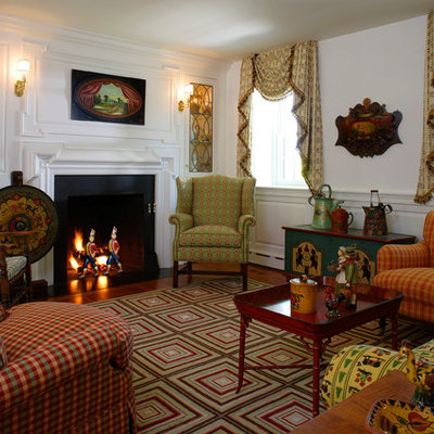 Example of a cottage formal and enclosed living room design in Philadelphia with white walls, a standard fireplace and no tv