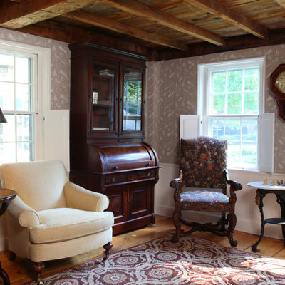 Example of a mid-sized country formal and enclosed carpeted living room design in Boston with multicolored walls, no fireplace and no tv