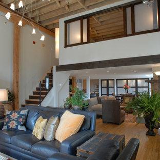 Esempio di un grande soggiorno stile americano stile loft con pareti bianche, camino classico e cornice del camino in mattoni