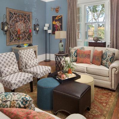 Elegant formal medium tone wood floor living room photo in Philadelphia with blue walls