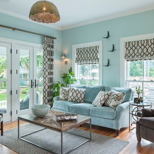 Design ideas for a traditional enclosed living room in Providence with blue walls and medium hardwood floors.