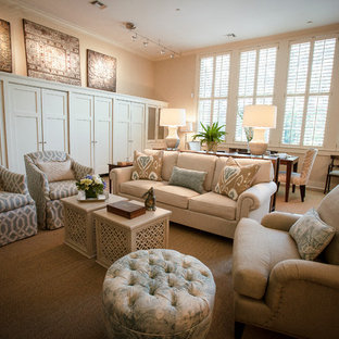 Example of a mid-sized classic formal and open concept medium tone wood floor living room design in Atlanta with beige walls, no fireplace and a media wall