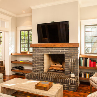 Example of an arts and crafts enclosed living room design in Atlanta with a standard fireplace and a wall-mounted tv