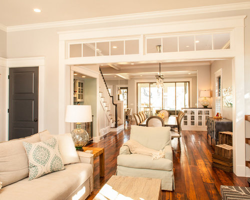 Inspiration for a craftsman enclosed medium tone wood floor living room  remodel in Atlanta with beige