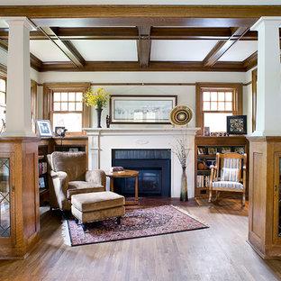Ejemplo de salón de estilo americano con paredes blancas, suelo de madera oscura, chimenea tradicional, marco de chimenea de ladrillo y suelo marrón