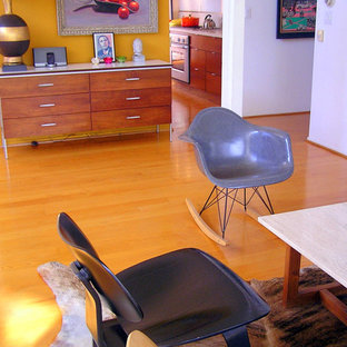Inspiration for a 1960s living room remodel in Orange County with yellow walls