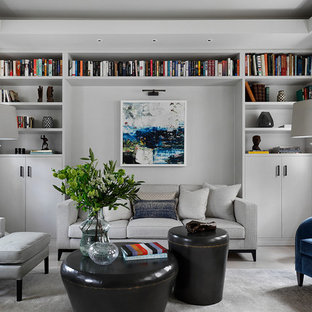 Inspiration for a contemporary living room in London with a reading nook, white walls and concrete flooring.