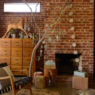 Living room - eclectic living room idea in Adelaide with a standard fireplace and a brick fireplace