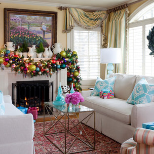 Inspiration for a timeless formal living room remodel in Little Rock with yellow walls and a standard fireplace
