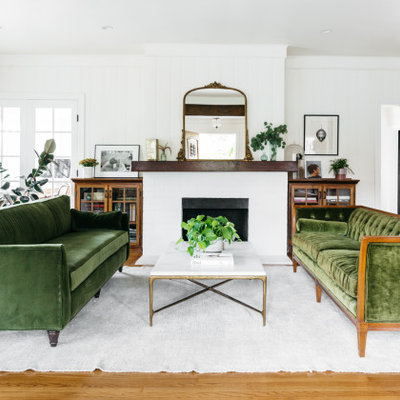Inspiration for a transitional medium tone wood floor and brown floor living room remodel in Los Angeles with white walls and a standard fireplace