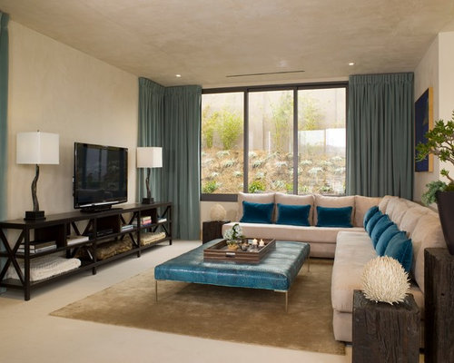 Contemporary living room idea in Los Angeles with beige walls and a tv stand