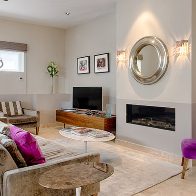 Mid-sized trendy formal living room photo in London with gray walls, a standard fireplace and a tv stand