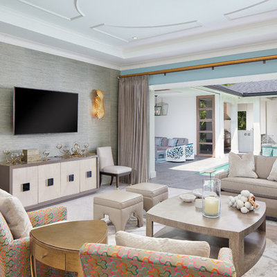 Example of a transitional living room design in Orlando with blue walls and a wall-mounted tv
