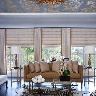 Example of a huge transitional living room design in Los Angeles with blue walls