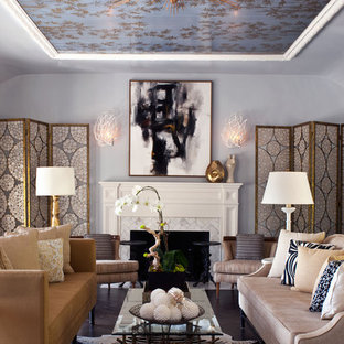This is an example of a traditional living room in Los Angeles with blue walls and a standard fireplace.