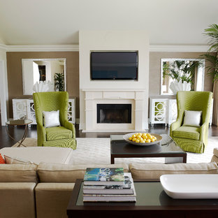 Example of a trendy living room design in Los Angeles with beige walls, a standard fireplace and a wall-mounted tv