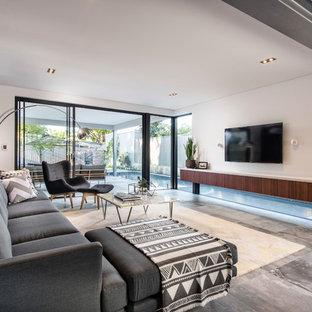 Foto di un soggiorno industriale di medie dimensioni e stile loft con pareti bianche e pavimento in gres porcellanato