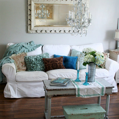 Inspiration for a shabby-chic style living room remodel in Other with white walls