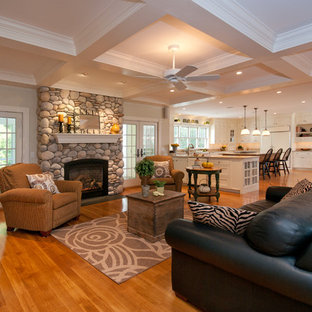 Example of a classic living room design in Boston with a standard fireplace and a stone fireplace