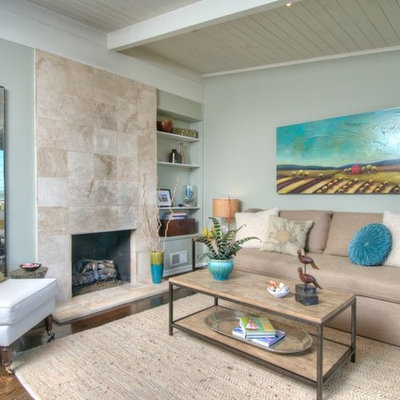 Trendy living room photo in San Francisco with blue walls and a standard fireplace