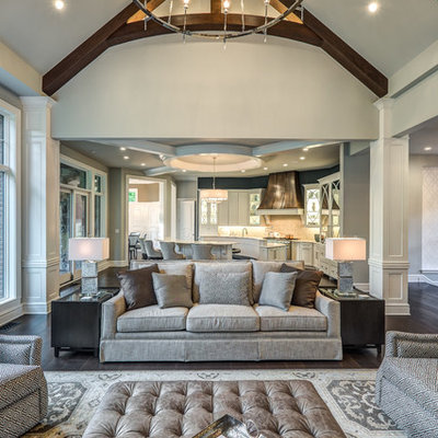 Living room - large transitional open concept dark wood floor and brown floor living room idea in Cincinnati with gray walls, a standard fireplace, a tile fireplace and a wall-mounted tv