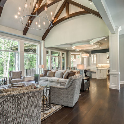Example of a large transitional open concept dark wood floor and brown floor living room design in Cincinnati with gray walls, a standard fireplace, a tile fireplace and a wall-mounted tv