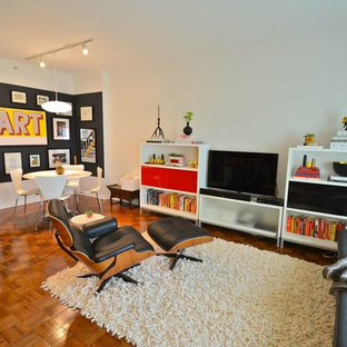 Mid-sized 1960s medium tone wood floor living room photo in Minneapolis with white walls, no fireplace and a tv stand