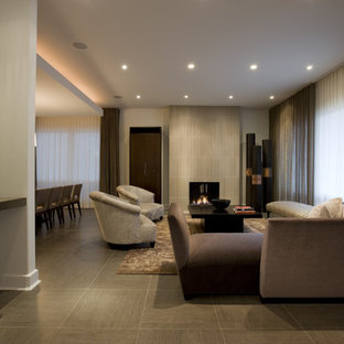 Trendy porcelain floor living room photo in Chicago with a tile fireplace