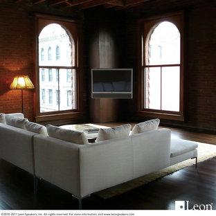 Imagen de salón tipo loft, contemporáneo, de tamaño medio, con suelo de madera oscura y televisor colgado en la pared
