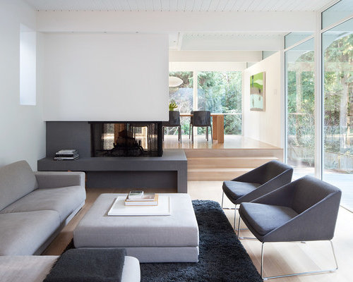 Foto e idee per living living moderno con camino bifacciale for Living con camino