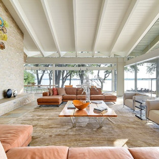 Example of a large mid-century modern open concept and formal slate floor and multicolored floor living room design in Austin with a standard fireplace and a brick fireplace