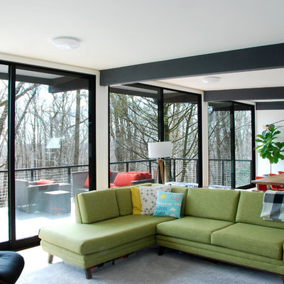 Living room - mid-sized 1960s open concept cork floor and brown floor living room idea in Philadelphia with white walls, a standard fireplace, a plaster fireplace and a wall-mounted tv