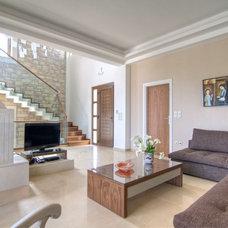 Contemporary Living Room by NINOS CONSULTANCY CONSTRUCTION